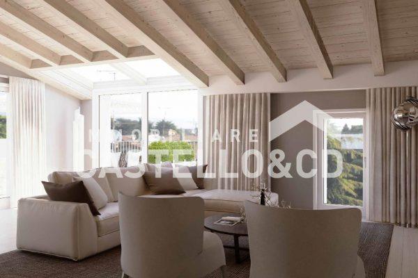 Elegante attico bilocale con piscina